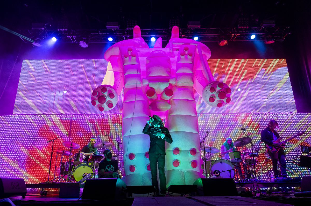 Backed by an inflatable Yoshimi, Wayne Coyne performs Sunday with Flaming Lips at Riot Fest in Douglass Park.