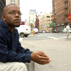 """In this file photo from June 5, 2003, former New York Times reporter Jayson Blair poses for a portrait in the SoHo neighborhood of New York. After a plagiarism scandal, Blair has been working as a life coach in northern Virginia since 2007.  The ex-New York Times reporter best known for fabricating and plagiarizing says his experience hitting the lows helps him relate to people, and the respected psychologist who hired him into his practice agrees: """"Jayson is now using his talents for good."""""""