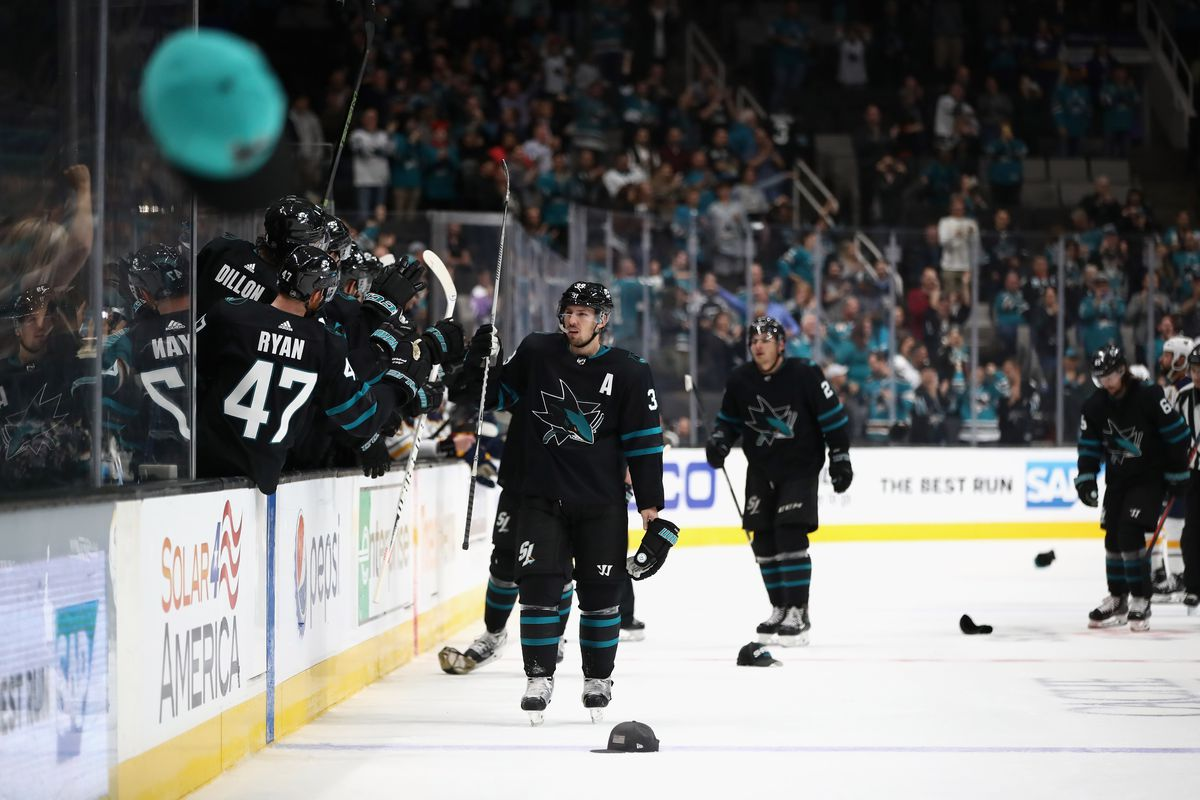 SAN JOSE, CA - OCTOBER 18: Logan Couture #39 of the San Jose Sharks is congratulated by teammates after he scored a hat trick against the Buffalo Sabres at SAP Center on October 18, 2018 in San Jose, California.