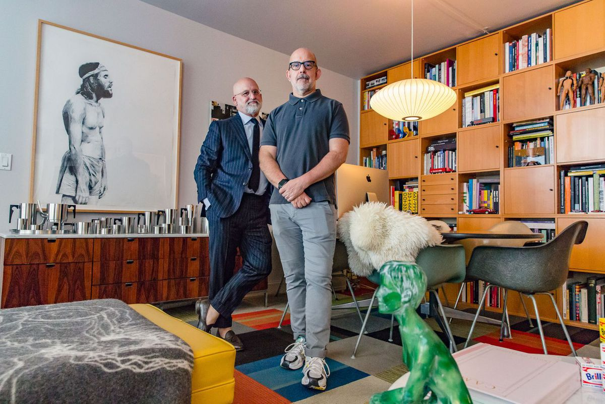 Tim Smith, left, and Bruce Hackney, right, recently received a rent-stabilized lease at their downtown apartment where the couple has lived for more than a decade.