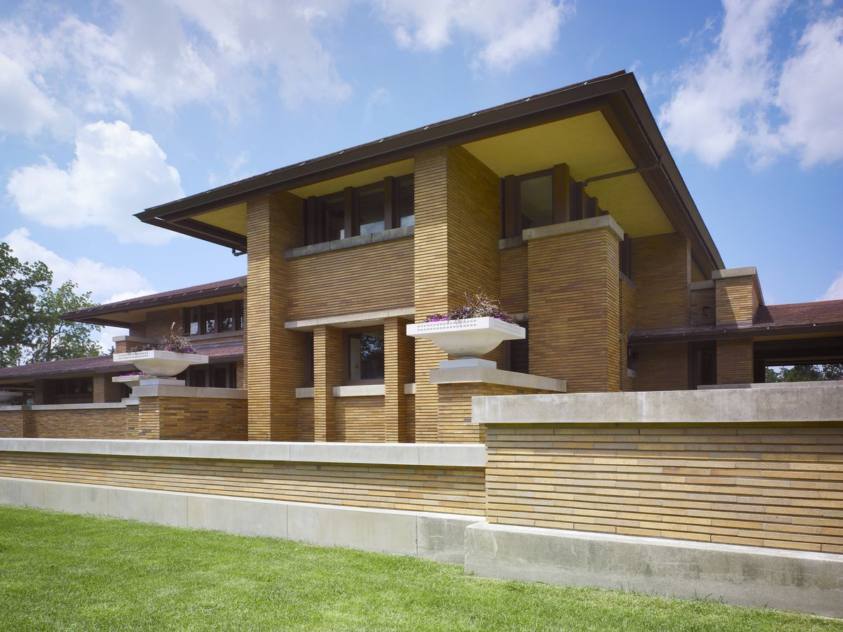 Darwin Martin House by Frank Lloyd Wright. The house has a multicolor brick facade with various terraced levels.