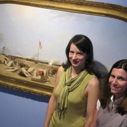 Lasley Steever, left, and Sara Arnold of the Gibbes Museum of Art stand by an 1864 Civil War painting by artist Conrad Wise Chapman at the museum in Charleston, S.C., on Wednesday, April 11, 2012. An image of the painting is one of more than 30,000 from art museums worldwide now available for viewing on the Internet through the Google Art Project. People can enter the Google Art Project site, see high resolution images and zoom in on details. It brings museum collections together in one place so art lovers don't have to go to various websites.