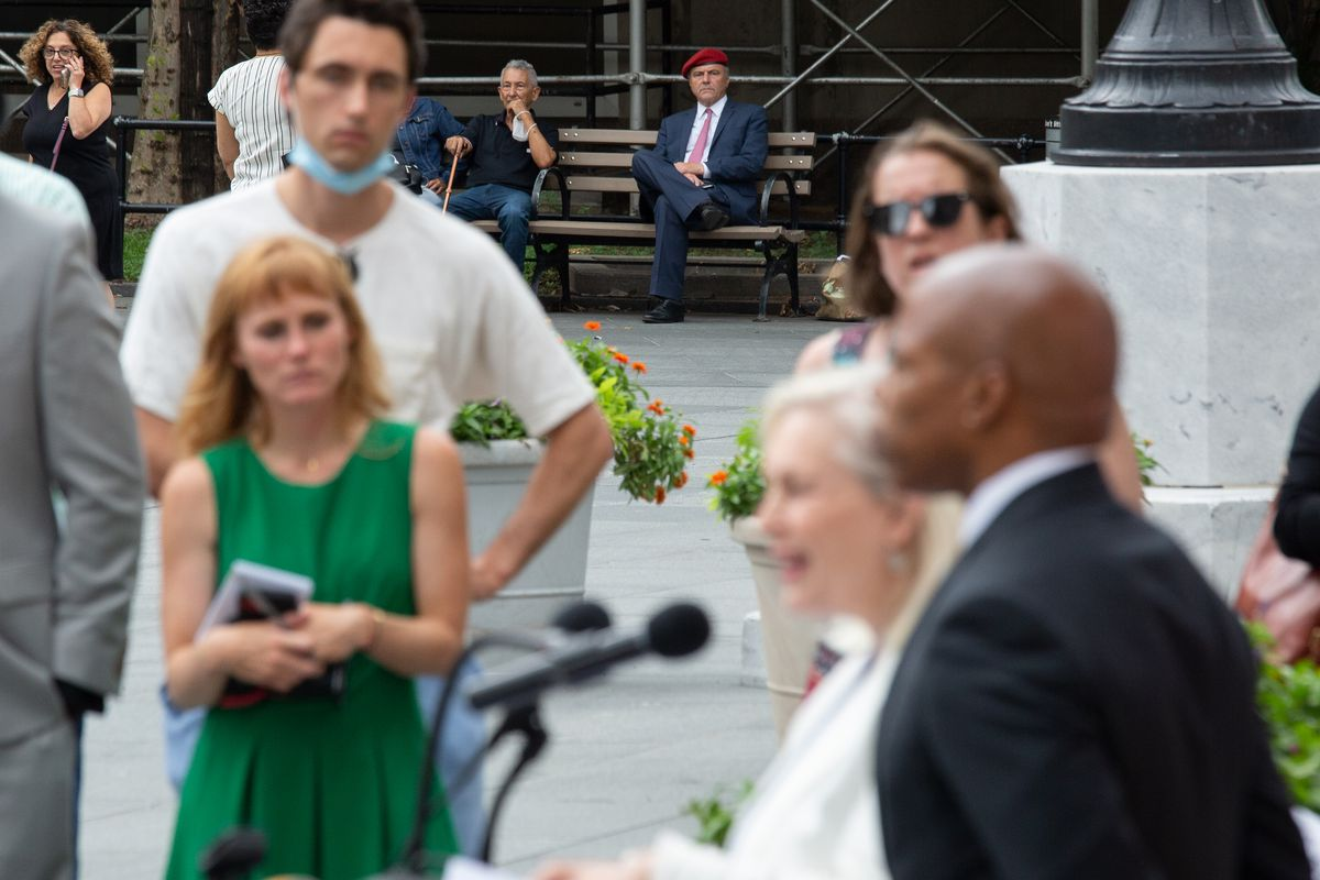 Curtis Sliwa watches his Democratic rival in the mayor's race, Eric Adams, and Senator Kirsten Gillibrand speak about gun violence at Brooklyn Borough Hall, July 19, 2021.