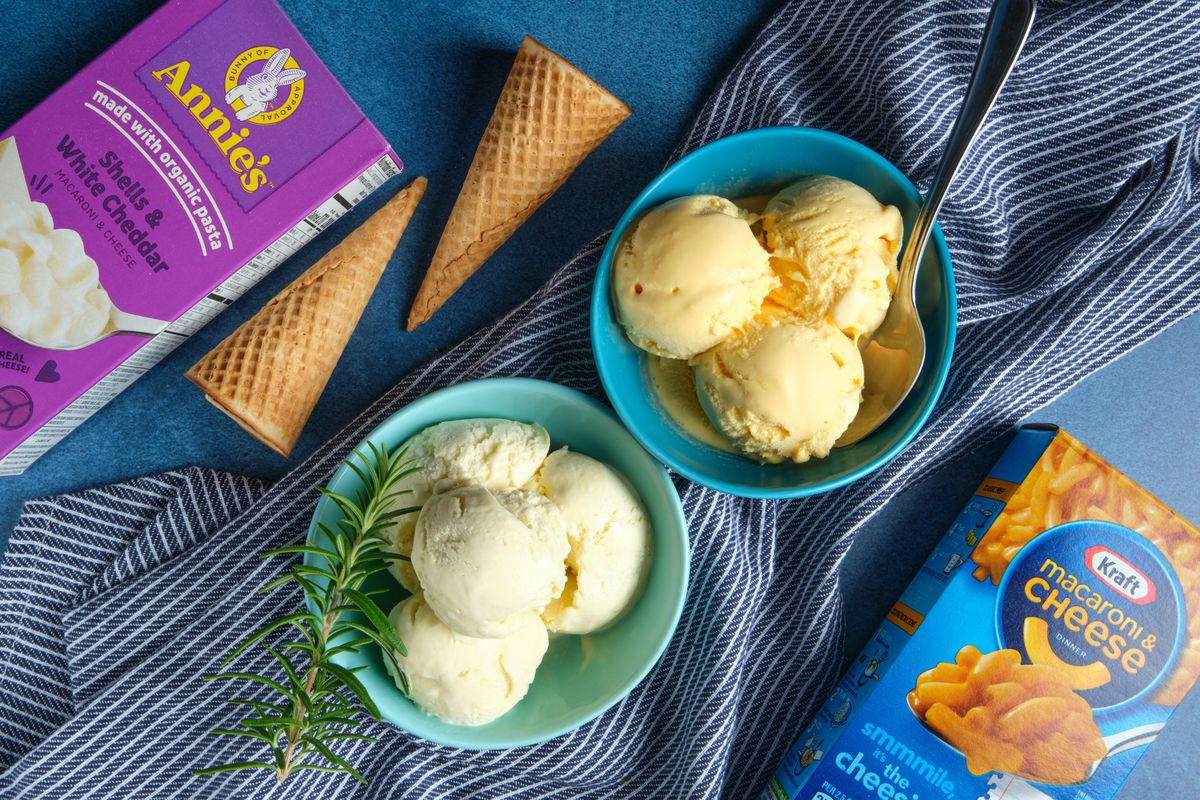 Two bowls of ice cream next to a box of Annie's Shells and White Cheddar and Kraft Macaroni and Cheese.