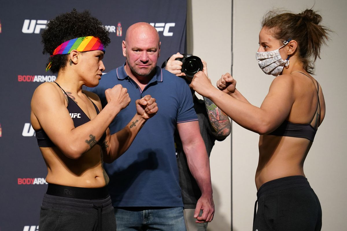Opponents Sijara Eubanks and Sarah Moras face off during the official UFC Fight Night weigh-in on May 12, 2020 in Jacksonville, Florida.