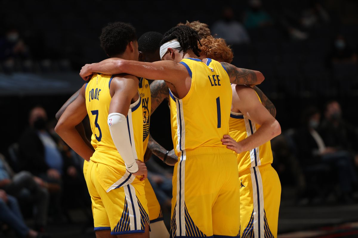 The Golden State Warriors huddle up during the game against the Memphis Grizzlies on MARCH 20, 2021 at FedExForum in Memphis, Tennessee.