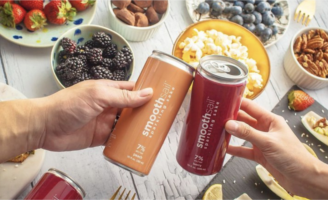 Cans of berry and peach SmoothSail sparkling sake