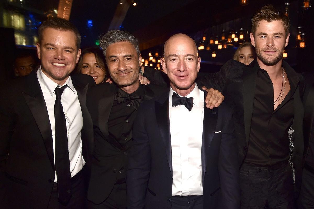 Matt Damon, Taika Waititi, Amazon founder and CEO Jeff Bezos, and Chris Hemsworth at the Golden Globe Awards.