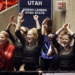 Utah's gymnastics team cheers during the floor exercise at the NCAA Salt Lake Regional Gymnastics meet on Saturday in Salt Lake City.