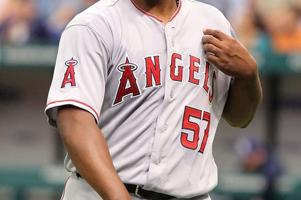 April 26, 2012; St. Petersburg, FL, USA; Los Angeles Angels starting pitcher Jerome Williams (57) walks back to the dugout in the second inning against the Tampa Bay Rays at Tropicana Field. Mandatory Credit: Kim Klement-US PRESSWIRE