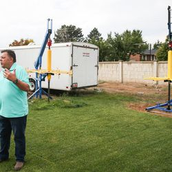 John Renouard, founder and president of WhoLives, talks to journalists about the Village Drill, two of which are seen in the background, at his home in South Jordan on Friday, Sept. 15, 2017.