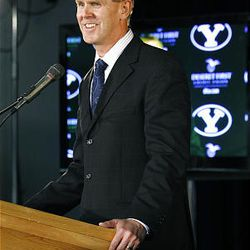 BYU A.D. Tom Holmoe smiles as he answers questions after announcing BYU going independent in football and joining the WCC for other sports, as well as, their contract with ESPN   Wednesday.