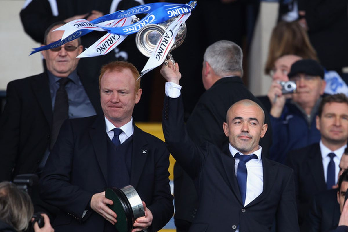 Creatively cropped to show Alex McLeish with the trophy he will retain.