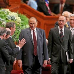 President Thomas S. Monson, with counselors President Henry B. Eyring and President Dieter F. Uchtdorf enter the afternoon session of the 183rd Semiannual General Conference of The Church of Jesus Christ of Latter-day Saints Saturday, Oct. 5, 2013, in Salt Lake City.