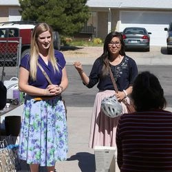 Sister Whitney Stoker, left, from Kennewick, Wash., and Sister Lauren Yoshimoto, from San Jose, Calif., visit neighborhoods in the Nevada Las Vegas Mission Friday, March 14, 2014, in Henderson.