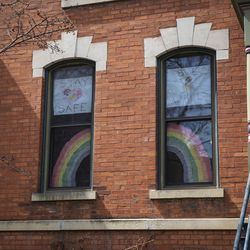 Homes in the Wicker Park neighborhood display messages of hope and positivity during the coronavirus pandemic, Monday afternoon, April 6, 2020.