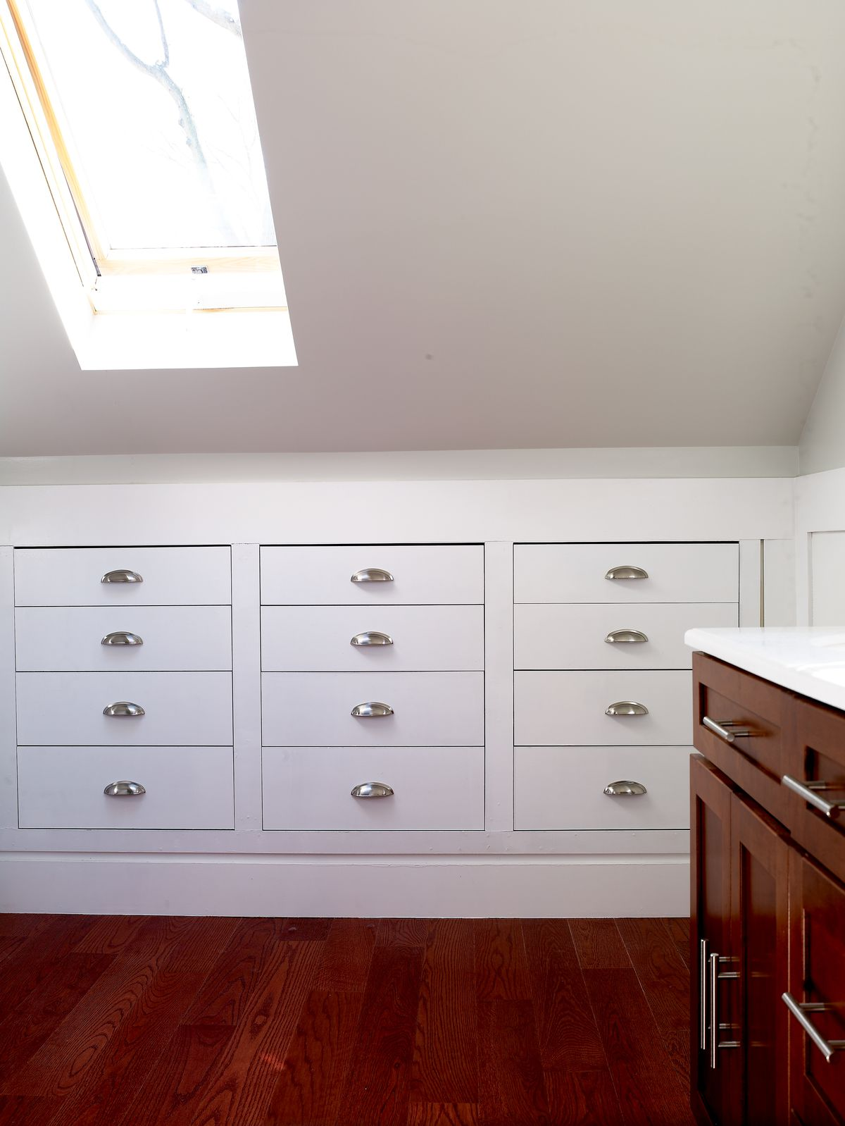 Recessed chest of drawers in attic.