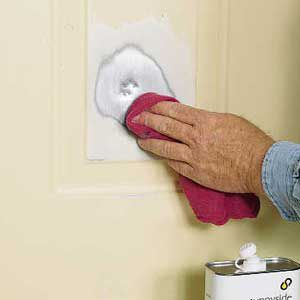 <p>Clean and degrease the sanded area with a soft, clean cloth dampened with either acetone or rubbing alcohol.</p>