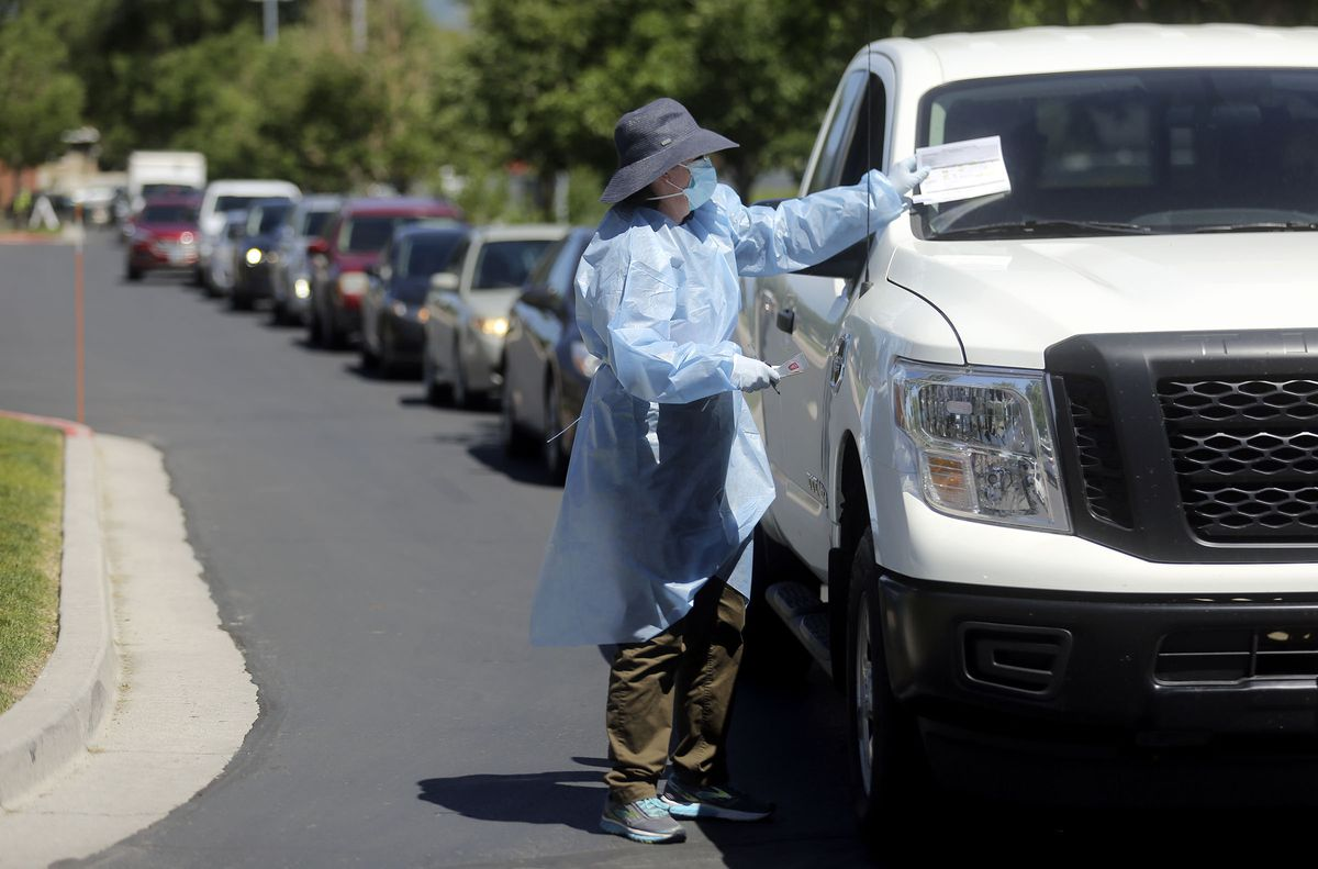 People wait in their vehicles for drive-thru COVID-19 testing outside of Glendale Middle School in Salt Lake City on Monday, June 22, 2020.