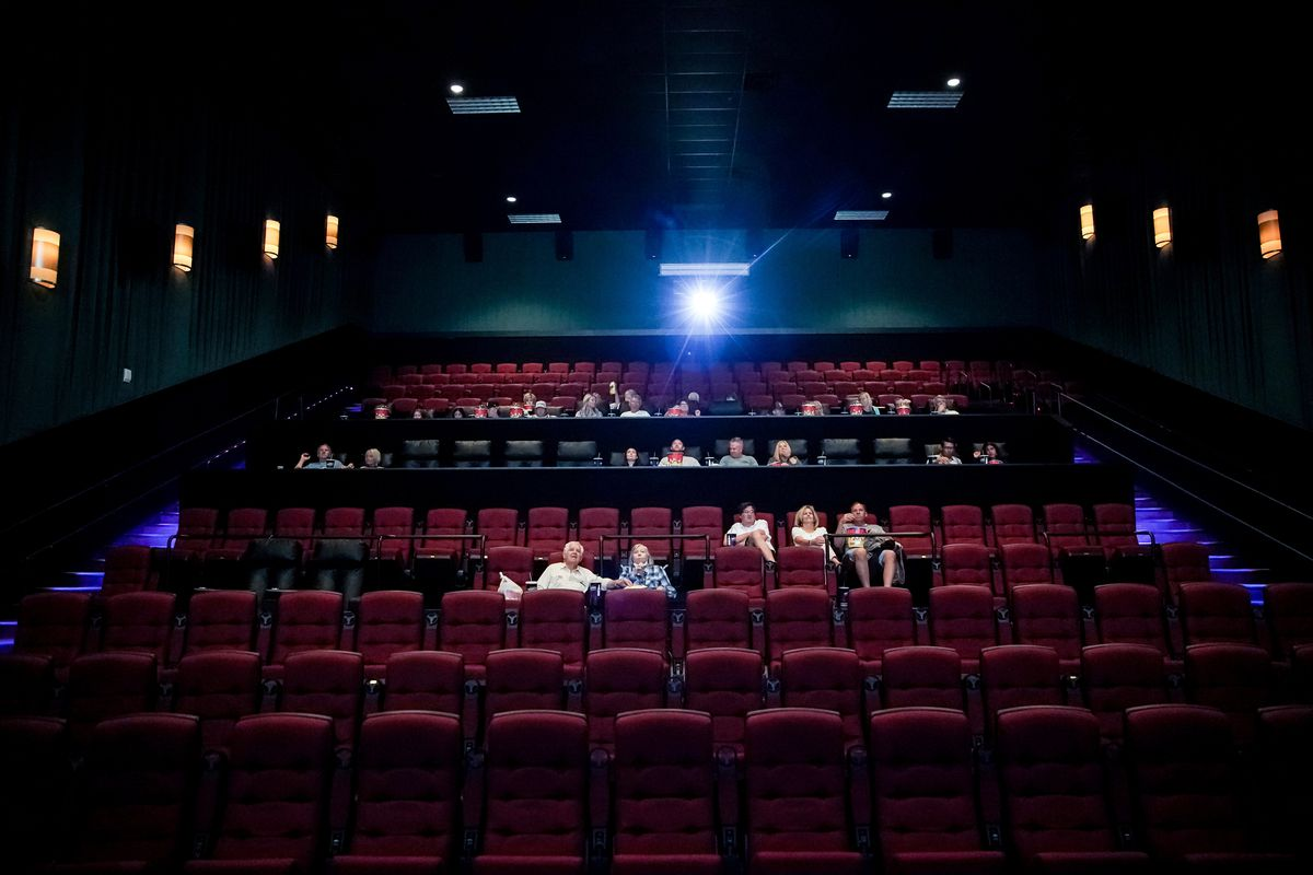A group attends a private screening at the Megaplex Theatres at Legacy Crossing in Centerville on Friday, May 29, 2020. Select Megaplex Theatres have been offering private family screenings for groups of up to 20 people.
