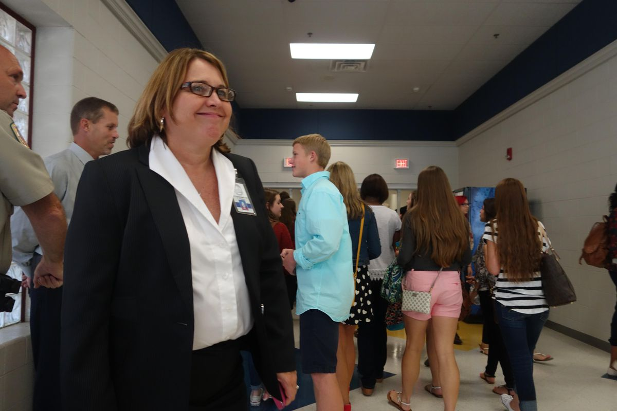 Arlington Superintendent Tammy Mason greets high school students last August on the first day of school for the new district near Memphis. (2014)