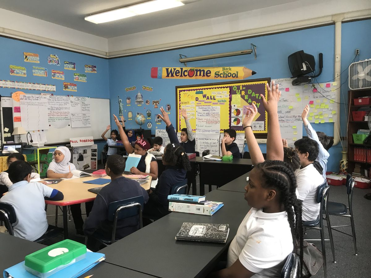 Students in Kenya Posey's classroom at Davison Elementary-Middle School rush to back up their conclusions about a novel they're reading.