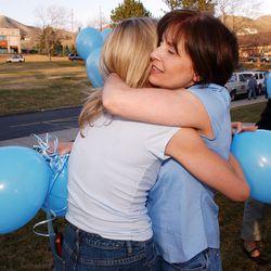 Smart family friends Alison Reed and Ann Farnsworth hug after Elizabeth Smart was found Mar 12, 2003.