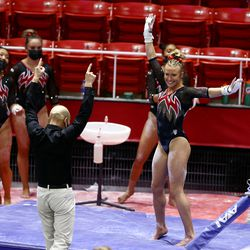 Utah's Abby Paulson turns in celebrations after bars routine as Utah and Washington compete in an NCAA gymnastics meet at the Huntsman Center in Salt Lake City on Saturday, Jan. 30, 2021. No. 4 Utah won 197.475 to 193.300.