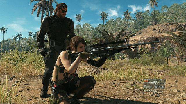 Snake stands over Quiet as she looks down her sniper rifle in a screenshot from Metal Gear Solid 5: The Phantom Pain.