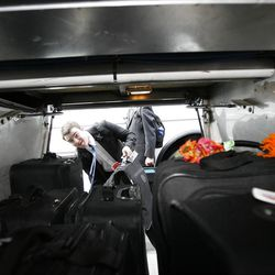 Elder John Scoggin loads his luggage on the bus to leave the Provo Missionary Training Center of The Church of Jesus Christ of Latter-day Saints in Provo, Utah Tuesday, Feb. 15, 2011.