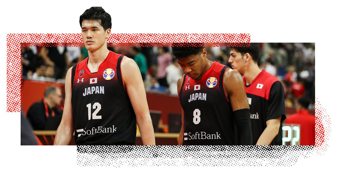 Yuta Watanabe and two teammates walking on the basketball court.