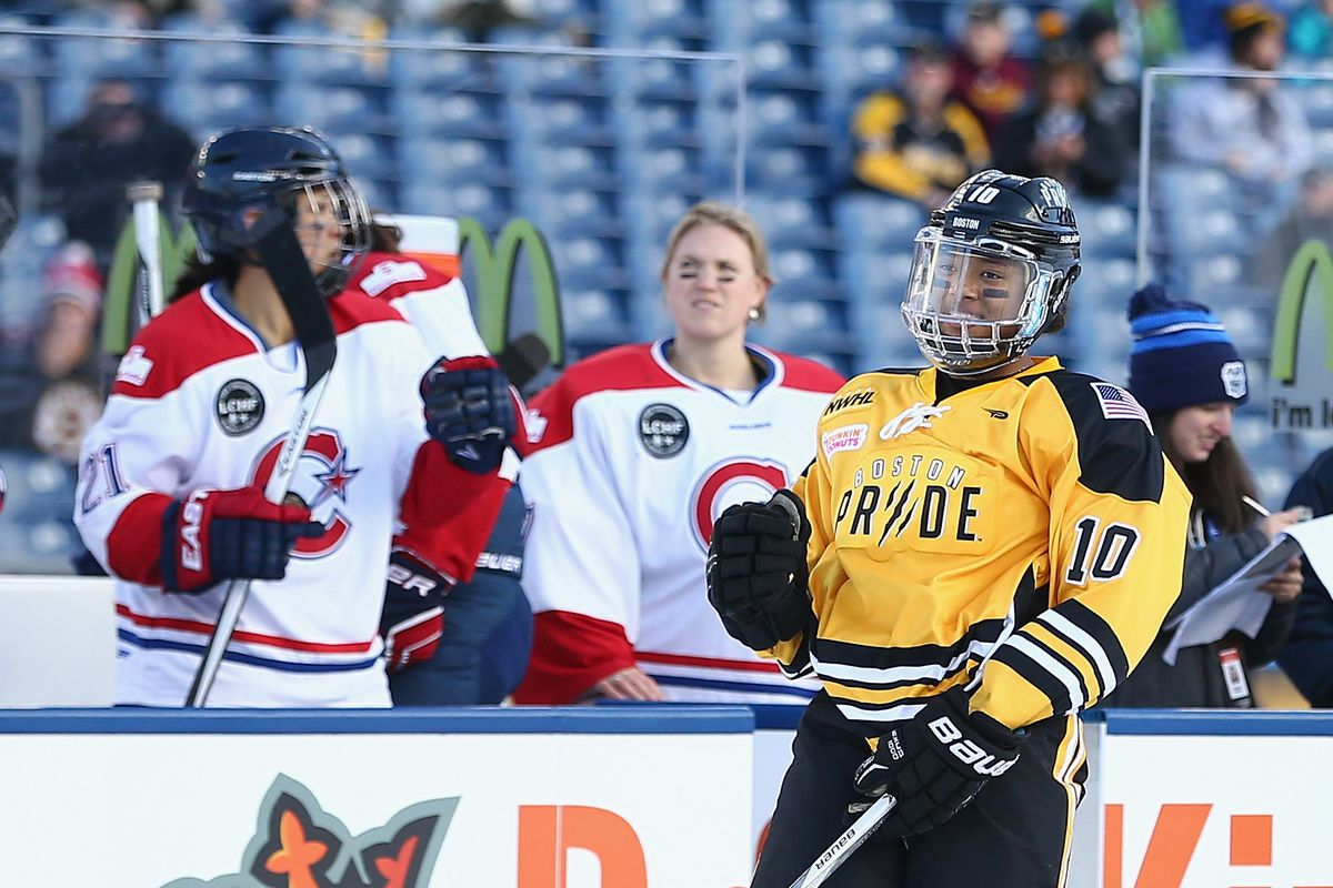 DECEMBER 31: Blake Bolden #10 and the Boston Pride (NWHL) celebrate a second period goal against the Les Canadiennes (CWHL) during the Outdoor Womens Classic at Gillette Stadium on December 31, 2015 in Foxboro, Massachusetts