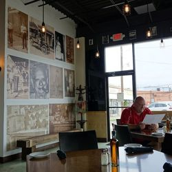 """Family photos adorn the walls. Says Superneau, """"My grandfather ran a grocery, and my partner Tom Macaluso's grandfather ran a grocery down the street, so it's funny that two generations later we've now opened a business together too."""""""