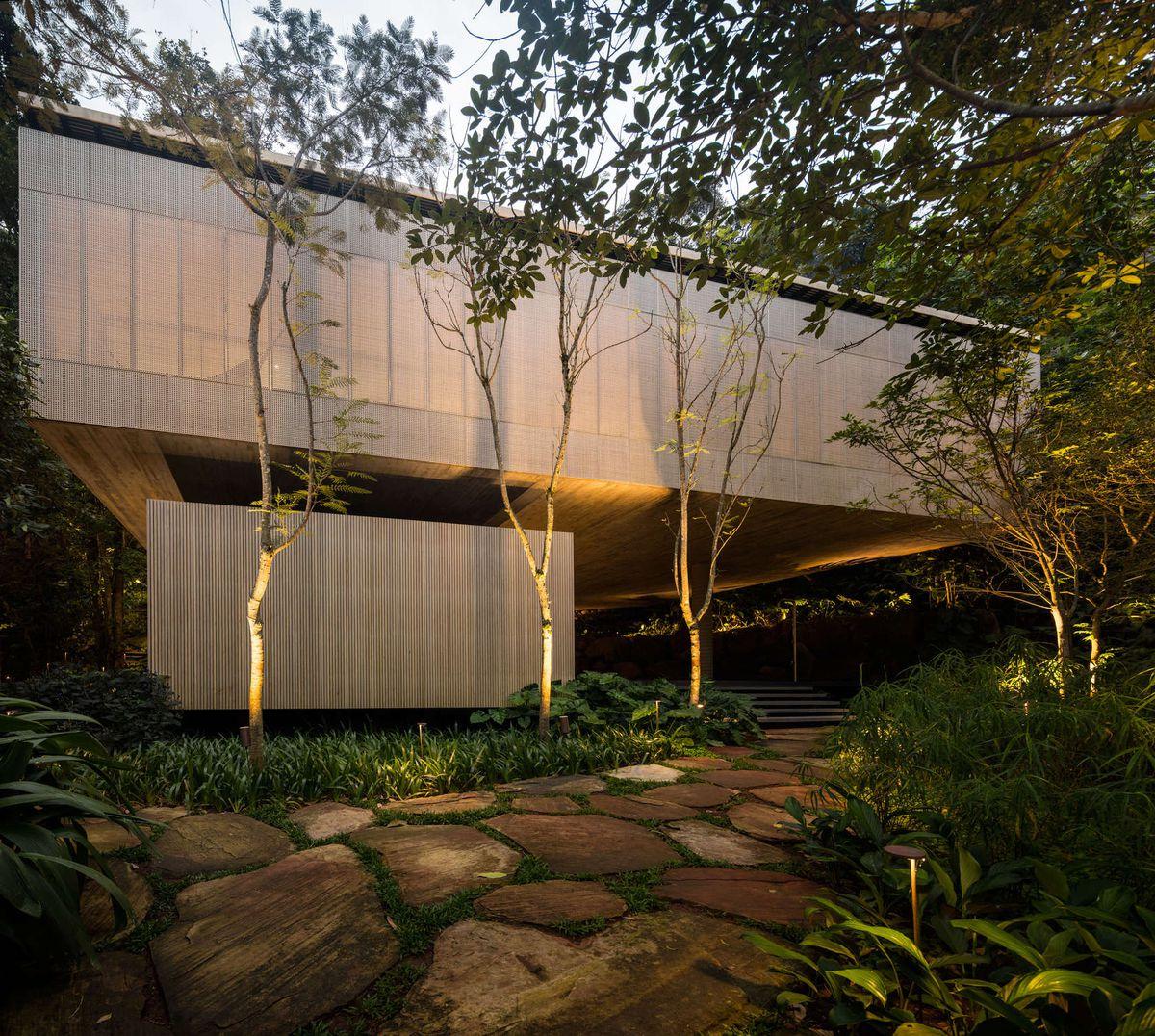 Stunning modern house in brazils rain forest has cozy sunken living room green roof