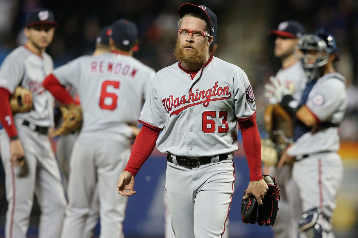"""Washington Nationals' closer Sean Doolittle gets """"punched in the face"""" by the New York Mets in 6-1 loss..."""