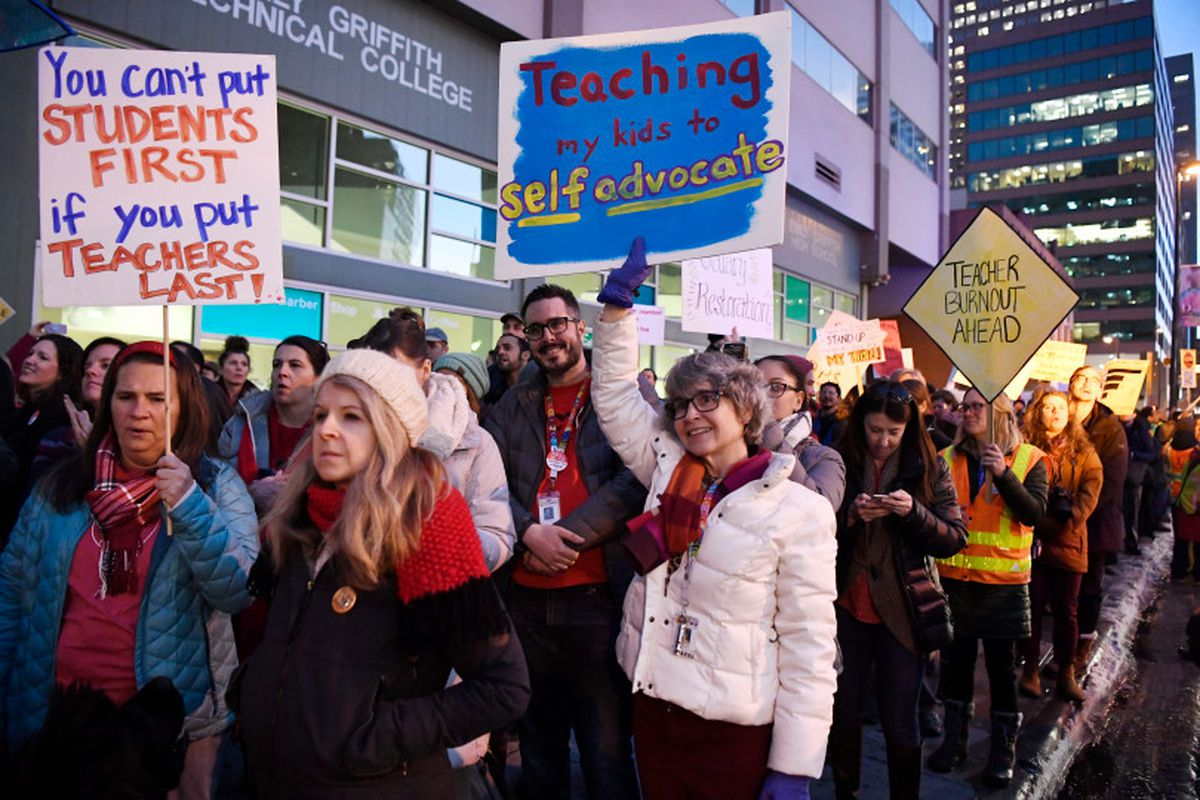 Denver Classroom Teachers Association teachers and supporters rally out in front of the Denver Public Schools headquarters on January 30, 2019, demanding better wages and urging the state not to get involved in a possible strike.