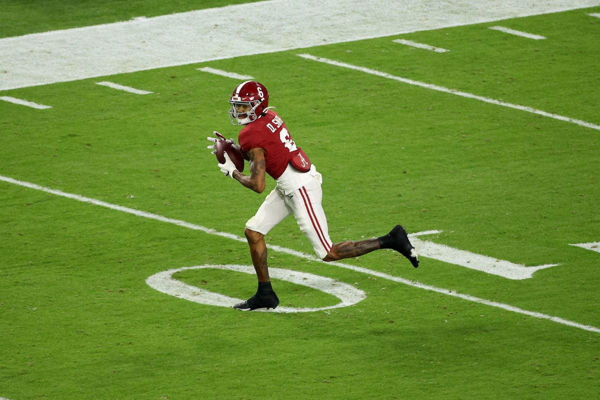 DeVonta Smith of the Alabama Crimson Tide pulls in a pass against the Ohio State Buckeyes during the College Football Playoff National Championship held at Hard Rock Stadium on January 11, 2021 in Miami Gardens, Florida.