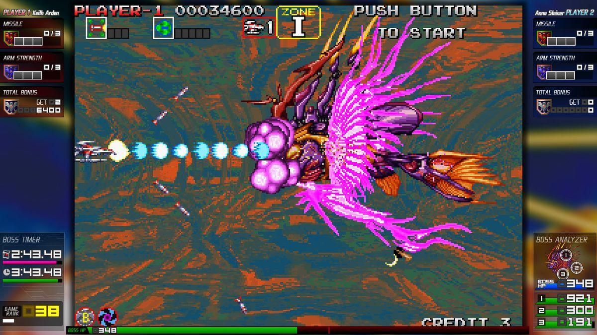 A spaceship attacks a robotic alien fish in Darius Cozmic Collection on Nintendo Switch.