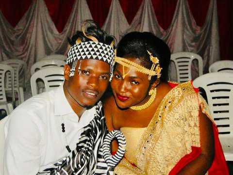 Celestine Mugisha and his wife, Winniefred Akello, pose for a photo in Mbarara, Uganda in November 2018 when Mugisha traveled to Africa to provide Akello's family with the wedding dowry.