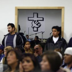 Members of the Latino community in the Hyrum area attend a town meeting in Hyrum, UT December 13, 2006 to address concerns and issues surrounding the raid of the Swift & Co., a meat-packing plant in Hyrum December 12th by ICE agents targeting illegal workers.