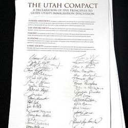 A document called the Utah Compact supporting  immigration reform at the State Capitol in Salt Lake City Thursday.