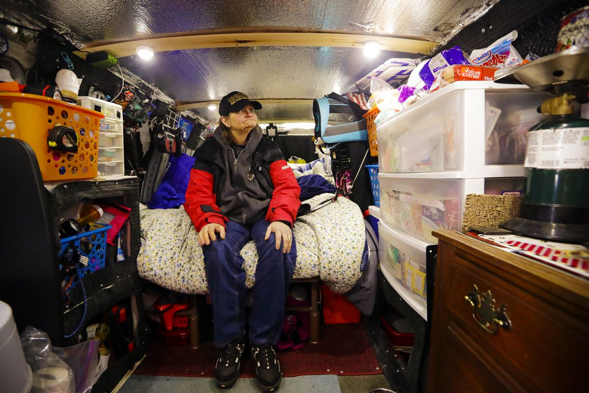 March 5: Tamara Bancroft sits inside her van, where she lives with her partner among the two-dozen or so vehicles housing homeless single women in a church parking lot in Kirkland, Washington. Some of the obstacles faced by the women in finding permanent