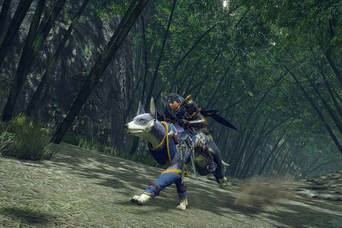 A hunter rides on his dog Palamute through a wooded trail in Monster Hunter Rise.