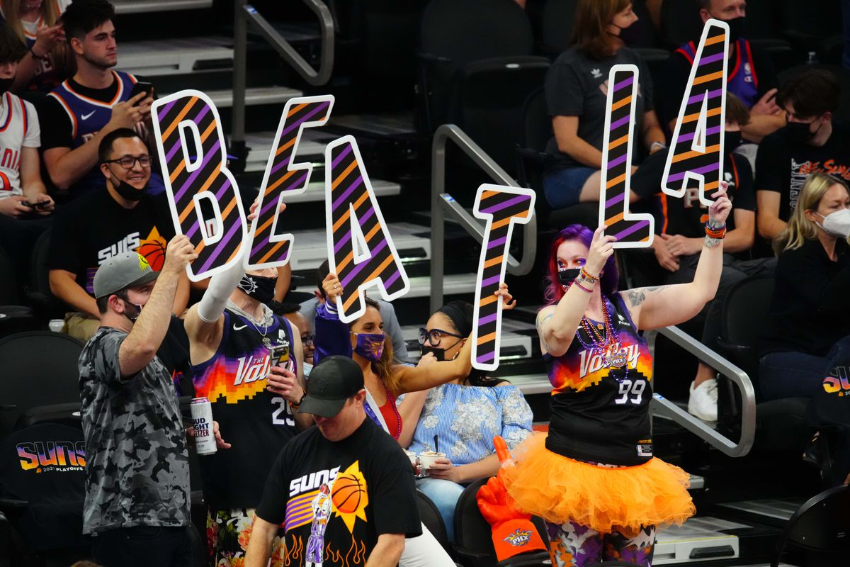 Phoenix Suns fans hold signs that spell out Beat LA in the crowd against the Los Angeles Lakers during game one in the first round of the 2021 NBA Playoffs