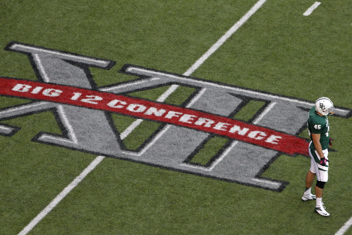 Baylor's Matt Ritchey stands on the field by a Big 12 Conference logo during game against TCU in Waco, Texas, Oct. 13, 2012.