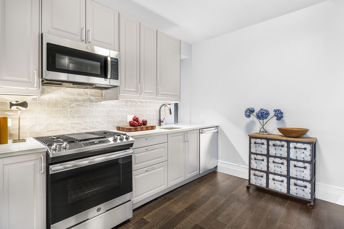 A kitchen with beige cabinetry.