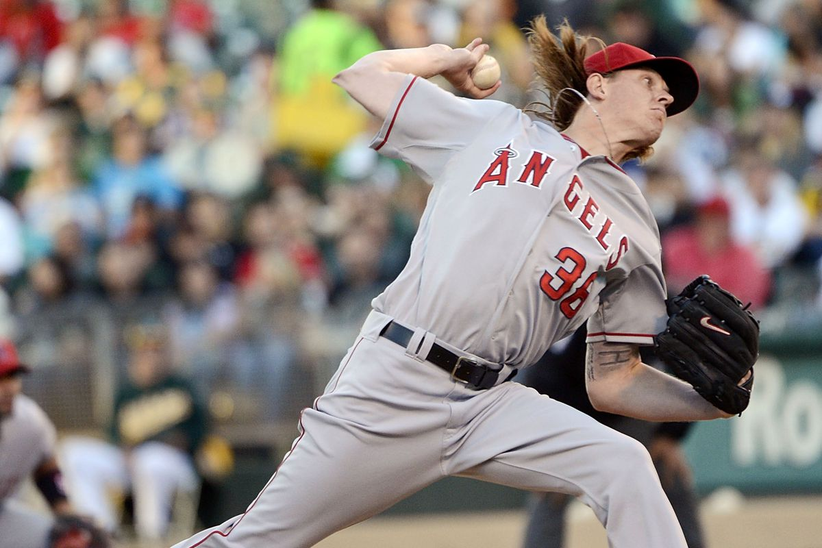 OAKLAND, CA - AUGUST 06:  Jered Weaver #36 of the Los Angeles Angels of Anaheim pitches against the Oakland Athletics at O.co Coliseum on August 6, 2012 in Oakland, California.  (Photo by Thearon W. Henderson/Getty Images)