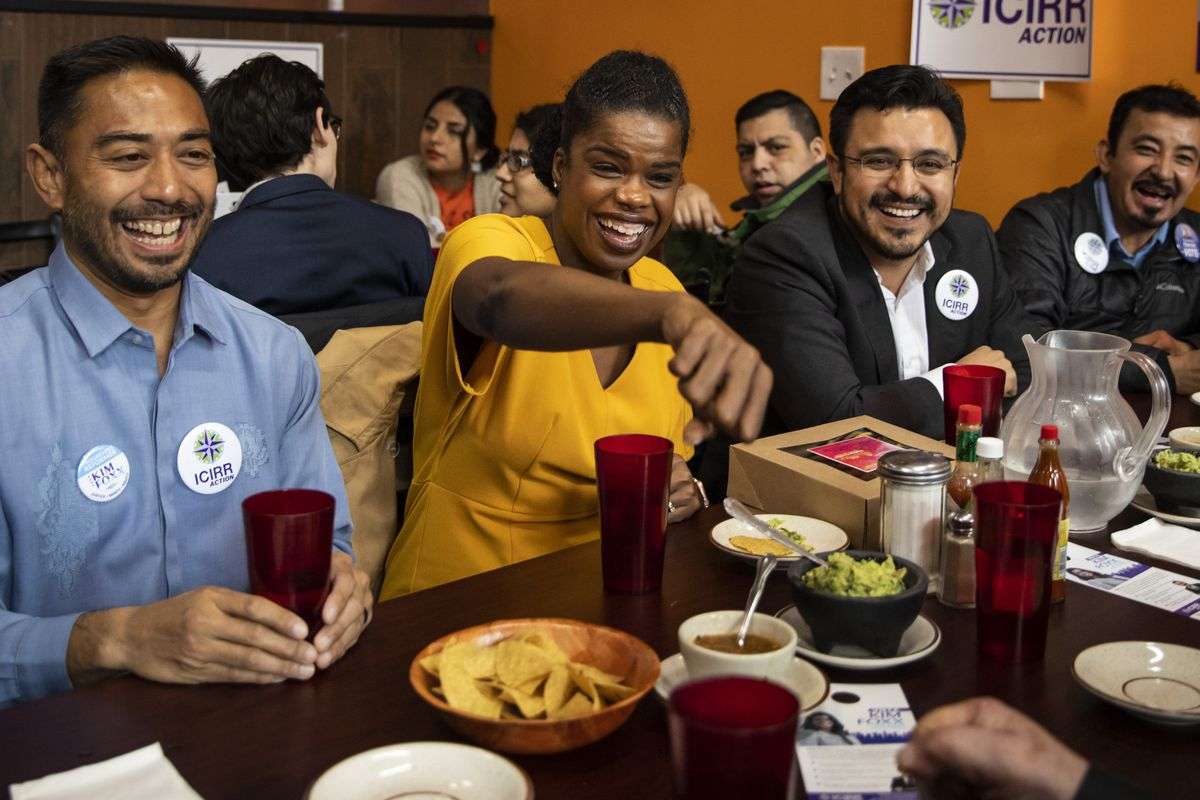 Cook County State's Attorney Kim Foxx, center, enjoys lunch with Lawrence Benito, left,  executive director of the Illinois Coalition for Immigrant and Refugee Rights, and Ald. Byron Sigcho-Lopez (25th), right.