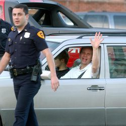 FILE - Ed Smart waves as he leaves the police staion after finding Elizabeth Smart.