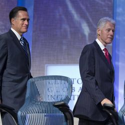 Former President Bill Clinton and Republican presidential candidate, former Massachusetts Gov. Mitt Romney arrive at the Clinton Global Initiative convention in New York, Tuesday, Sept. 25, 2012.